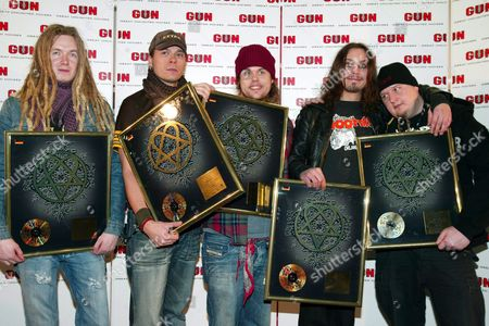 Members of the Finnish Rock Band 'Him' Pose with the Golden Record Handed to Them During the Popshow the Dome in Berlin Late Friday 05 March 2004 Well Known International Stars Such As Nelly Furtado Him and Patrick Nuo Participated in the Event Germany Berlin