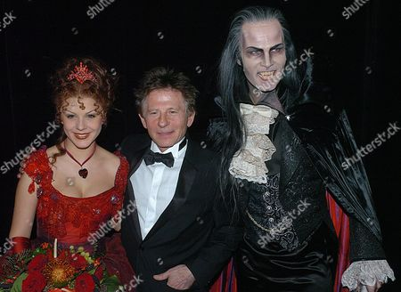 Stock Picture of German Actress Jessica Kessler (l) Polish Director Roman Polanski (c) and Main Character Thomas Borchert in the Role of 'Graf Von Krolock' After the Opening Night of the Musical 'Dance of the Vampires' Directed by Roman Polanski at the 'Neue Flora' Theatre in Hamburg 07 December 2003 Germany Hamburg