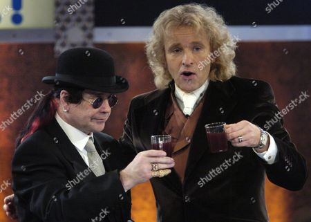 British Rock Singer Ozzy Osborne Joins German Television Star Thomas Gottschalk on the German Television Programme Wetten Das 'Guess That' For a Gluehwein when the Two of Them Came Together in Freiburg Southern Germany on Saturday 06 December 2003 Germany Freiburg