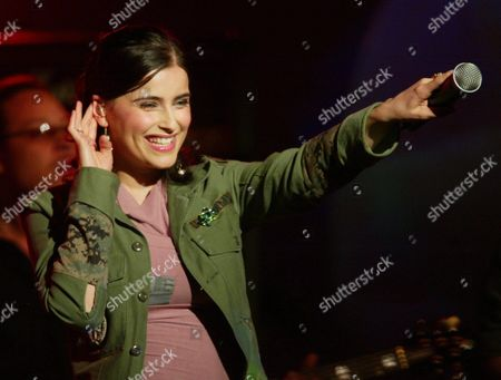Canadian Singer Nelly Furtado Points the Microphone Towards the Audience During a Performance in Berlin's Velodrome on Friday 5 March 2004 During the German Pop Music Show 'The Dome ' Twenty International and National Stars Were Scheduled to Appear on the Program Presented by German Television Station Rtl Ii Among Them Kylie Minogue Nelly Furtado Him and Patrick Nuo Germany Berlin