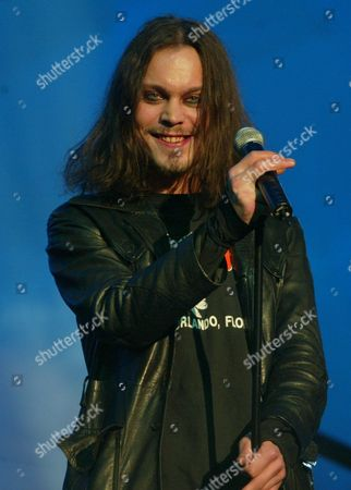 Ville the Lead Singer of the Finnish Band Him Holds the Microphone During a Performance in Berlin's Velodrome on Friday 5 March 2004 During the German Pop Music Show 'The Dome ' Twenty International and National Stars Were Scheduled to Appear on the Program Presented by German Television Station Rtl Ii Among Them Kylie Minogue Nelly Furtado Him and Patrick Nuo Germany Berlin