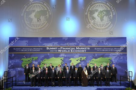 Stock Photo of Back row, from left to right: Mario Draghi, Chairman, Financial Security Forum; Ban Ki-Moon, Secretary-General of the United Nations; Silvio Berlusconi, Prime Minister of Italy; Jose Manuel Barroso, President of the European Commission; Gordon Brown, British Prime Minister; Angela Merkel, Chancellor of Germany; Jose Luis Rodriguez Zapatero, President of Spain and President of the European Council; Recep Tayyip Erdogan, Prime Minister of Turkey; Dr. Manmohan Signh, Prime Minister of India; Steven Harper, Prime Minister of Canada; Kevin Rudd, Prime Minister of Australia; Taro Aso, Prime Minister of Japan; Robert Zoellick, President, World Bank Group; and Dominique Strauss-Kahn, Managing Director, International Monetary Fund (IMF).  Front row, from left to right: Jan Kees de Jager Deputy Secretary of Finance, the Netherlands; Dmitry A. Medvedev, President of Russia; Felipe Calderon Hinojosa, President of Mexico; Susilo Bamgang Yudhoyono, President of Indonesia; Luiz Inacio Lula da Silva, President of Brazil; George W. Bush, President of the United States; Hu Jintao, President of China; Abdullah bin Abd al-Aziz Al Saud, King of Saudi Arabia; Nicolas Sarkozy, President of France; Lee Myung-bak, President of the Republic of Korea; and Kgalema Motlanthe, President of South Africa.