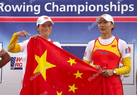 Gold Medalists Liang Tian and Li Qin of China Cheer on the Podium at the 2007 World Rowing Championships Near Munich Germany 01 September 2007 Germany Oberschleissheim