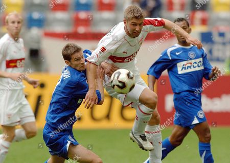 German Thomas Hitzelsperger (c) of Vfb Stuttgart Fights For the Ball with Arne Friedrich (2nd L) of Hertha Bsc Berlin During Their German League Cup Football Match at the Ltu Arena in Duesseldorf Germany Saturday 23 July 2005 Germany Duesseldorf