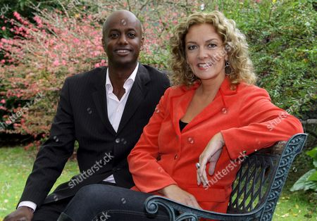 Joint Hosts of Tv Talk Show 'Talk Mit Tietjen' Bettina Tietjen (r) and Interim Co-host Yared Dibaba (l) Smile During a Press Conference in Hanover Germany 08 October 2007 Dibaba was Introduced As Tietjen's New Co-host Replacing Eva Herman who was Sacked by Public Broadcaster Ndr For Her Disputed and Naive Statements on the Role of the Mother Associated with the Third Reich the First Show with the New Hosts Will Be Televised by Ndr on 12 October Germany Hanover