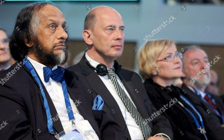 Nobel Peace Prize Laureate and Chair of the Intergovernmental Panel on Climate Change (ipcc) Rajendra Pachauri Sits Next to German Minister of Transport Wolfgang Tiefensee Finnland's Transport Minister Anu Vehvilaeinen and Secretary General of the International Transport Forum (itf) Jack Short (l-r) During the Itf in Leipzig Germany 29 May 2008 51 Transport Ministers and a Few Hundred Experts Attended the Global Platform For Transport Logistics and Mobility in Order to Give a Fresh Impetus to Strategies on How to Counter the Threatening Climatic Disaster According to the Oecd the Transport Sector Has a 23 Per Cent Share in the Worldwide Co2 Emissions the International Transport Forum Therefore Investigates How to Lower Emissions in Automobile and Air Traffic As Well As in Shipping Germany Leipzig