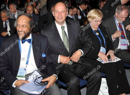 Nobel Peace Prize Laureate and Chair of the Intergovernmental Panel on Climate Change (ipcc) Rajendra Pachauri Sits Next to German Minister of Transport Wolfgang Tiefensee Finnland's Transport Minister Anu Vehvilaeinen and Secretary General of the International Transport Forum (itf) Jack Short (l-r) During the Itf in Leipzig Germany 29 May 2008 51 Transport Ministers and a Few Hundred Experts Attended the Global Platform For Transport Logistics and Mobility in Order to Give a Fresh Impetus to Strategies on How to Counter the Threatening Climatic Disaster According to the Oecd the Transport Sector Has a 23 Per Cent Share in the Worldwide Co2 Emissions the International Transport Forum Therefore Investigates How to Lower Emissions in Automobile and Air Traffic As Well As in Shipping Photo: Peter Endig Germany Leipzig