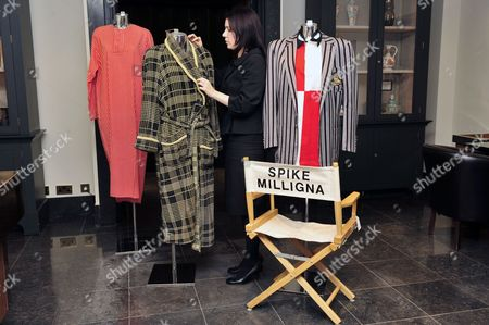 """Clothes and a directors chair with  """"Spike Milligna"""" printed on the back."""