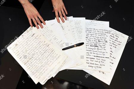 Hand written manuscripts and a fountain pen