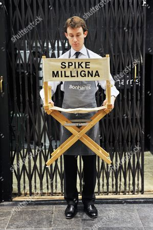 """A director's chair with  """"Spike Milligna"""" printed on the back."""