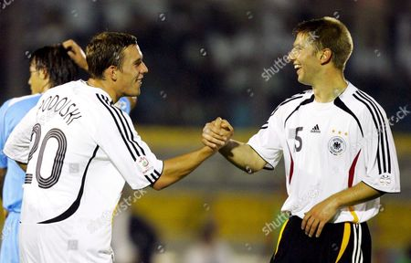 German Players Lukas Podolski (l) and Thomas Hitzelsperger Celebrate After Hitzelsberger Scored Against San Marino During the Euro 2008 Qualification Match in Serravalle Wednesday 06 September 2006 Germany Won the Match 13-0 San Marino Serravalle
