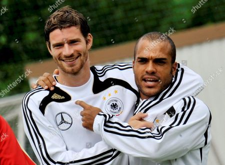 German National Soccer Players Arne Friedrich (l) and David Odonkor Gesture During a Training Session in Tenero Near Locarno Switzerland 05 June 2008 Team Germany is Preparing For the Upcoming Uefa Euro 2008 Switzerland Schweiz Suisse Tenero