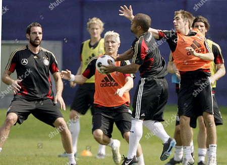 From Left to Right Germany's Christoph Metzelder Marcell Jansen Bastian Schweinsteiger David Odonkor Philipp Lahm and Mario Gomez Turn to a Game of Handball During a Training Session of the National Soccer Squad in Tenero Switzerland 24 June 2008 Ahead of Their Euro 2008 Soccer Semi Final Against Turkey Switzerland Schweiz Suisse Tenero