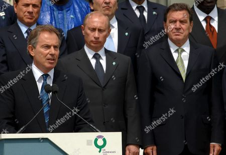 British Prime Minister Tony Blair (front) Makes a Statement Prior to the Family Portrait of the G8 Summit at the Hotel's Terrace in Gleneagles Scotland Friday 08 July 2005 in the Background the Picture Shows Italian Prime Minister Silvio Berlusconi Russian President Vladimir Putin and German Chancellor Gerhard Schroder (from L to R) the World's Most Powerful Leaders Got Down to Talks in Gleneagles Scotland Discussing Aid to Africa and Climate Change the Summit's Programme Had to Be Changed Due to a Series of Explosions That Caused Casualties and Deaths in London United Kingdom Gleneagles