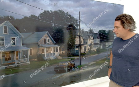Photographer Gregory Crewdson From New York City Stands in Front of One of His Large-sized Photograph Which is Part of the 'Beneath the Roses' Picture Series Exhibited at the 'Kunstverein' Art Gallery in Hanover Germany Thursday 01 September 2005 65 Pictures Are on Display at the Exhibition Which Runs Until 30 October 2005 Featuring the Most Important Works of the 43-year Old Photographer Germany Hanover