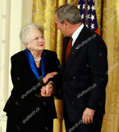 United States President George W. Bush congratulates actress Olivia de Havilland after presenting her with the 2008 National Medals of Arts award