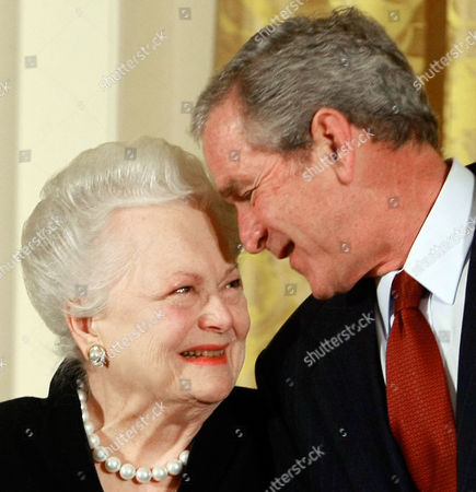 United States President George W. Bush congratulates actress Olivia de Havilland before presenting her with the 2008 National Medals of Arts award