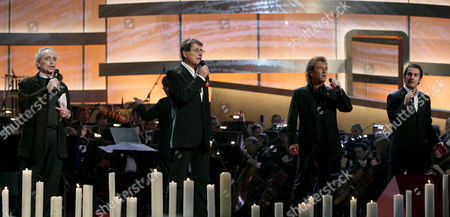 Stock Image of Startenor Jos? Carreras Sings with Udo Juergens Peter Maffay and Piero Mazzocchetti (l-r) at the Dress Rehearsal of the 12th Jose Carreras Benefit Gala in Leipzig Germany Thursday 14 December 2006 Carreras Invited Nearly 20 Artists to Collect Money For Leukaemia Patients and Hopes For Donations of Several Million Euros the Tenor Singer Had Leukaemia Himself the Gala Will Be Broadcasted the Same Night on German Tv Channel Ard Germany Leipzig