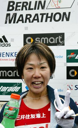 Japan's Yoko Shibui Celebrates After Winning the Berlin Marathon in Berlin Sunday 26 September 2004 Some 36 000 Runners Took Part in the Race Germany Berlin