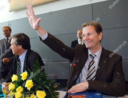 Fdp Chairman Guido Westerwelle (r) Smiles Prior to the Fdp's Post-election Meeting in Berlin Germany Monday 19 September 2005 Next to Westerwelle Sits Fdp Chairman of the Faction Wolfgang Gerhardt the Conservative Union of Cdu and Csu Has Only Marginaly Won the 2005 Bundestag Election Since There is No Majority For a Coalition Between Cdu/csu and Fdp the Door is Open For a So-called 'Traffic Light' Coalition of Spd Fdp and the Green Party a So-called 'Black Traffic Light' Coalition of Cdu/csu Fdp and Green Party is Also Possible Germany Berlin