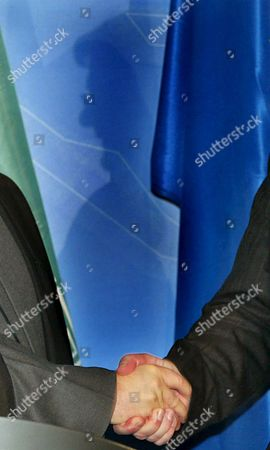 German Foreign Minister Joschka Fischer (in the Background As Silhouette) Shakes Hands with Iranian Chief Nuclear Negotiator Hassan Rohani (l) During a Press Conference at the Foreign Ministry in Berlin Germany Friday 25 February 2005 Both Politicians Met Prior to That For a Talk Germany Berlin