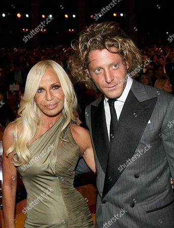Italian Designer Donatella Versace (l) and Lapo Elkann Grandson of Italian Fiat-founder Giovanni Agnelli Pose During the Gq Gala Event For the Presentation of the 'Men of the Year 2007' Prizes in Munich Germany 25 October 2007 For the Ninth Time the Magazine Honoured Outstanding Personalities From Cinema Television Music Business Fashion and Sports Germany Munich