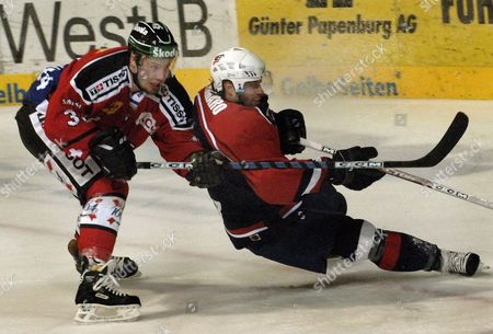 Stock Photo of Us Player Chris Ferraro (r) and Switzerland's Mathias Seger in Action in Front of the Swiss Goal During the Ice Hockey Nations Cup Switzerland Vs Usa at the Tui Arena in Hanover Germany Saturday 12 November 2005 Germany Hanover