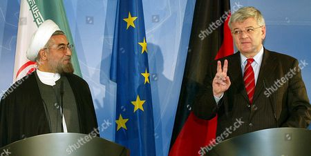 German Foreign Minister Joschka Fischer (r) Flashes the Victory Sign While Iranian Chief Nuclear Negotiator Hassan Rohani Stands Next to Him During a Press Conference at the Foreign Ministry in Berlin Germany Friday 25 February 2005 Both Politicians Met Prior to That For a Talk Germany Berlin
