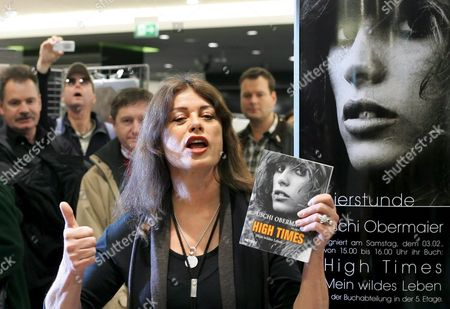 Stock Picture of Former Model Uschi Obermaier Poses with Her Autobiography in the Kaufhaus Des Westens ('kadewe') in Berlin Germany Saturday 03 February 2007 the Autobiography is Called 'High Times - Mein Wildes Leben' ('my Wild Life') and is Published by Heyne Publishers Germany Berlin