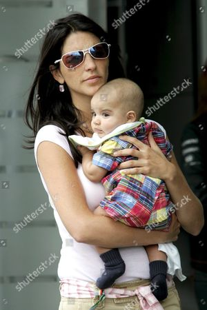 Stock Picture of Connie Montoya Wife of Columbian Formula One Driver Juan Pablo Montoya of Mclaren Mercedes Holds Her Baby Sebastien in the Paddock Before the Start of the German Formula 1 Grand Prix at Hockenheimring in Germany on Sunday 24 July 2005 Germany Hockenheim