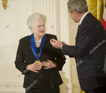 President Bush presents the 2008 National Medal of the Arts to actress Olivia de Havilland during a presentation ceremony of the 2008 National Medals of Arts and National Humanities Medals.