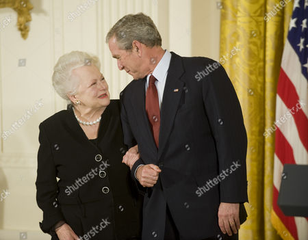 President George W Bush presents the 2008 National Medal of the Arts to actress Olivia de Havilland