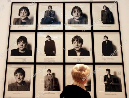Stock Photo of A Woman Stands in Front of a Wall with Head Shots of German Chancellor Merkel at the 'Haus Der Fotografie' in Hamburg Germany Tuesday 26 September 2006 the Exhibition 'The Heartbeat of Fashion' Presents 370 Photographs by 100 Artists From the F C Gundlach Collection From Wednesday 27 September 2006 Until 7 January 2007 Germany Hamburg