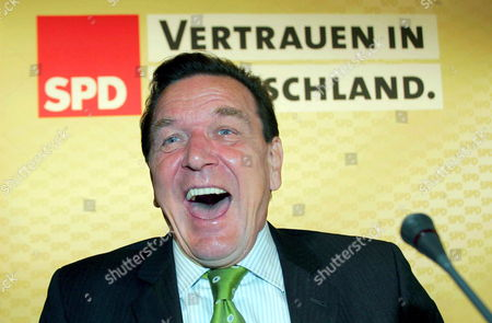 German Chancellor Gerhard Schroeder Bursts with Laughter in the Town Hall of Kassel Germany Friday 05 August 2005 the Chairmanship of the Social Democrats (spd) Met in Kassel to Settle the Last Details For the Federal Election Campaign After the Meeting More Than 300 Delegates of All Constituencies Will Debate Over Strategy Issues Germany Kassel