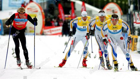 The Swedish Team Peter Larsson (2nd R) Fredrik Oestberg (3rd R) and Thobias Fredriksson Race Against Norwegian Skier Tor Arne Hetland in the Final Round of the Prelude to the World Cup in Cross-country Skiing Along the Embankment of the River Rhine in Duesseldorf Germany Saturday 22 October 2005 Swedish Skier Peter Larsson Won the First Place Around 4 000 Cubic Metre of Artificial Snow Were Delivered on 150 Trucks to Form the 800 Metre Long Piste on the Promenade the Run-up to the World Championship in Cross-country Skiing is Taking Place For the Fourth Time in Duesseldorf and Organisers Expect More Than 350 000 Spectators to Attend the Event Altogether 145 Athletes From 22 Countries Have Registered For the Competition Germany Duesseldorf