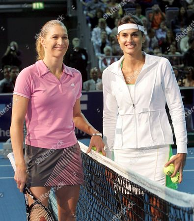 Former World Class Tennis Pros German Steffi Graf (l) and Argentinian Gabriela Sabatini Stand on the Net Prior to Their Exhibition Match in the Sap-arena in Mannheim Germany Saturday 15 October 2005 the Former Leader of the World Ranking List and Her Longtime Opponent From Argentina Played 40 Times Against Each Other on the Wta Protour Graf Now Living with Her Family in the Us Won 29 Times X Graf and Sabatini Won the Wimbledom Doubles Together in 1988 Germany Mannheim