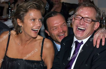 Stock Picture of (l-r) Countess Stephanie Von Pfuel (v L ) Prince Alexander Zu Schaumburg-lippe and Hair Stylist Gerhard Meir Share a Laugh During the Auction of 80 Works of Art by Artists and Celebrities to Raise Money For Sos Children's Villages the International Child Welfare Organisation Founded by Hermann Gmeiner in 1949 Germany Hamburg