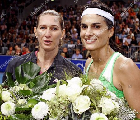 Former World Class Tennis Pros German Steffi Graf (l) and Argentinian Gabriela Sabatini Show Their Bouquets After the Exhibition Match in the Sap-arena in Mannheim Germany Saturday 15 October 2005 the Former Leader of the World Ranking List Defeated Her Longtime Contrahent From Argentina in a Highclass Match 6-4; 6-2 the Two World Stars Played a Match with Many Haunting Rallies in the Sap Arena in Mannheim Germany Six Years After the End of Her Career the Player From Bruehl Germany Gave Her Argentinian Friend No Chance 40 Times the Two Faced Each Other on the Wta Protour Graf Won 29 Times Germany Mannheim