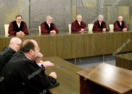 The 3rd Criminal Division of the German High Court Including Joerg-peter Becker Klaus Miebach Klaus Tolksdorf (chairman) Wolfgang Pfister and Erwin Hubert (background L-r) Announce Their Verdict in the Al-motassadeq Trial in Karlsruhe Germany Thursday 16 November 2006 in the Front Sit Al-modassadeq's Lawyers Udo Jacob (l) and Ladislav Anisic Germany's High Court Thursday Upheld the Conviction of Moroccan Mounir Al-motassadeq 32 As a Conspirator in the September 11 2001 Terrorist Attacks in the United States the Judges Said He was Also Guilty of Being an Accessory to 246 Murders They Referred the Case Back to a Lower Court For Renewed Sentencing This May Mean That He Will Receive More Than the Seven Years in Jail He was Given Last Year Germany Karlsruhe