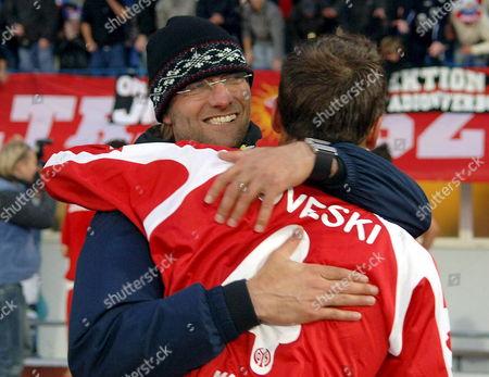 Stock Photo of Team Manager J?rgen Klopp (l) and Nikolce Noveski Celebrate After the Fsv Mainz Beat Keflavik 2-0 on Thursday 25 August 2005 in the Second Round of Uefa Qualifiers Played in Reykavik Iceland Iceland Reykjavik