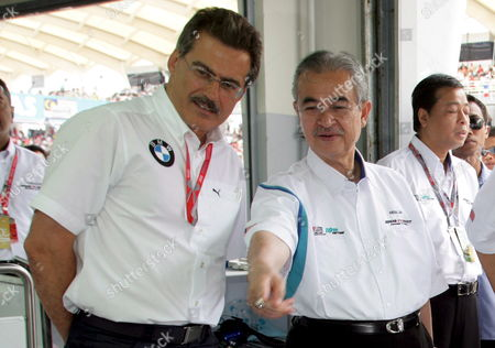 Bmw Motorsport Director German Dr Mario Theissen (l) and Malaysian Prime Minister Abdullah Ahmad Badawi (r) Look to the Bmw Sauber Formula One Racing Car at the Team Garage Before the Start of the Formula One Grand Prix of Malaysia at the Sepang Circuit Near Kuala Lumpur Malaysia 23 March 2008 Malaysia Sepang