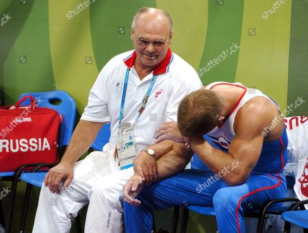 Alexei Nemov (r) of Russia and His Coach React After Judges Descission in the Men's Horizontal Bar Final at the Athens 2004 Olympic Games Monday 23 August 2004 Epa/dpa Tim De Waele Greece Athens