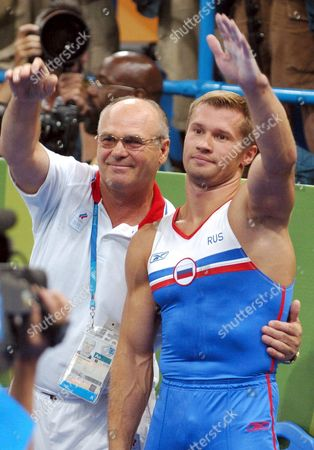 Alexei Nemov (r) of Russia and His Coach Gesture After Judges Descision in the Men's Horizontal Bar Final at the Athens 2004 Olympic Games Monday 23 August 2004 Epa/dpa Tim De Waele Greece Athens