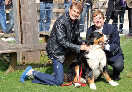 Us Actor and Singer David Hasselhoff (l) and the Founder of Animal Sancutary 'Gut Aiderbichl' Michael Aufhauser Pose with a Dog in Salzburg Austria 24 April 2010 Hasselhof Will Perform His New Song 'This Time Around' in the German Folk Music Television Show 'Musikantenstadl' on 24 April Austria Salzburg