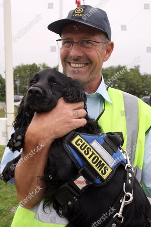 Danish Customs Officer Paul Petersen Poses with Sniffer Dog Luna at the Border Between Germany and Denmark in Froslev Denmark 05 July 2011 Danish Customs Officials on 05 July Were to Start Implementing Stricter Border Controls in a Bid to Fight International Crime Despite Concerns From Brussels That They Contravene the Rules of the European Union at the Crossing From Germany Denmark's Only Land Border 30 Additional Officers Were Scheduled to Begin Random Searches For the Crossing Across the Narrow Strait From Sweden an Extra 20 Officials Were to Be Deployed the European Commission and the German Government Have Criticized the Plan Which They Have Called a Potential Violation of the Right to Free Movement Across Internal Eu Borders Denmark Froslev
