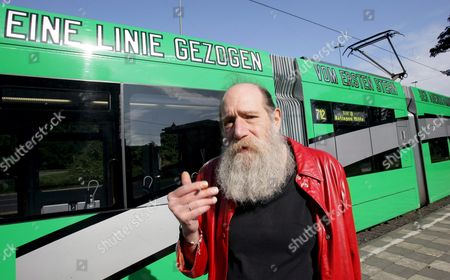 Us Artist Lawrence Weiner Poses in Front of a Tram He Has Inscribed with the Sentence 'A Line Drawn From the First Star of Dusk to the Last Star of Dawn' in German As Well As English in Duesseldorf Germany 22 September 2008 As Conceptual Artist Weiner Became Internationally Known For His Language Artworks Consisting of Short Mostly Puzzling Sentences Germany Duesseldorf