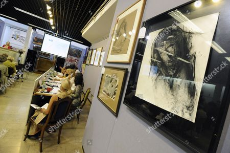 The Artwork 'Christuskopf' (christ Head) From Arnulf Rainer Hangs During an Art Auction at an Auction House in Munich ágermany 26 May 2011 the Painted Over Black and White Photo From 1981 was Sold For 10 500 Euros Germany Munich