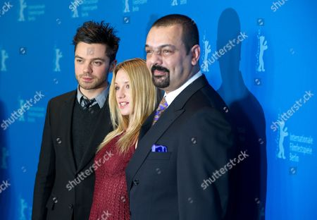 British Actor Dominic Cooper(l) and French Actress Ludivine Sagnier (c) and Iraqi Author Latif Yahia (r) Pose at a Photocall For the Film 'The Devil's Double' During the 61st Berlin International Film Festival in Berlin Germany 11 February 2011 the Film is Presented in the Panorama Section of the International Film Festival the 61st Berlinale Runs From 10 to 20 February 2011 Germany Berlin