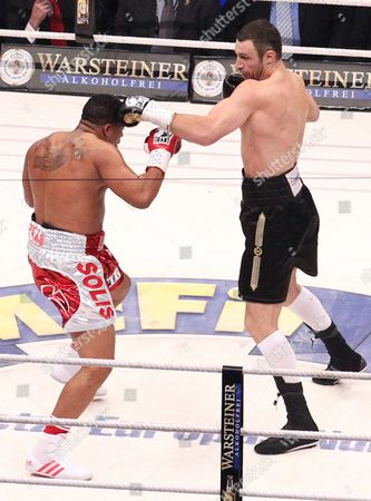 Ukrainian Heavyweight Boxing Title Holder Vitali Klitschko (r) Knocks Down Odlanier Solis of Cuba During the First Round of Their Wbc World Heavyweight Championship Fight in Cologne Germany 19 March 2011 Germany Cologne