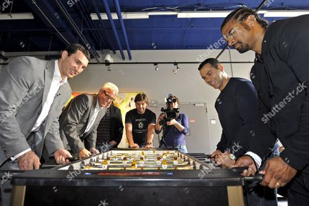 Ukranian Wbo Ibf and Ibo Heavyweight Champion Vladimir Klitschko (l) His British Contender David Haye (r) and Their Managers Bernd Boente (2-l) and Adam Booth (2-r) Play Table Soccer at Veltins Arena Stadium in Gelsenkirchen Germany 16 April 2009 Klitschko is Going to Defend His Titles Against Haye in the Stadium on 20 June Germany Gelsenkirchen